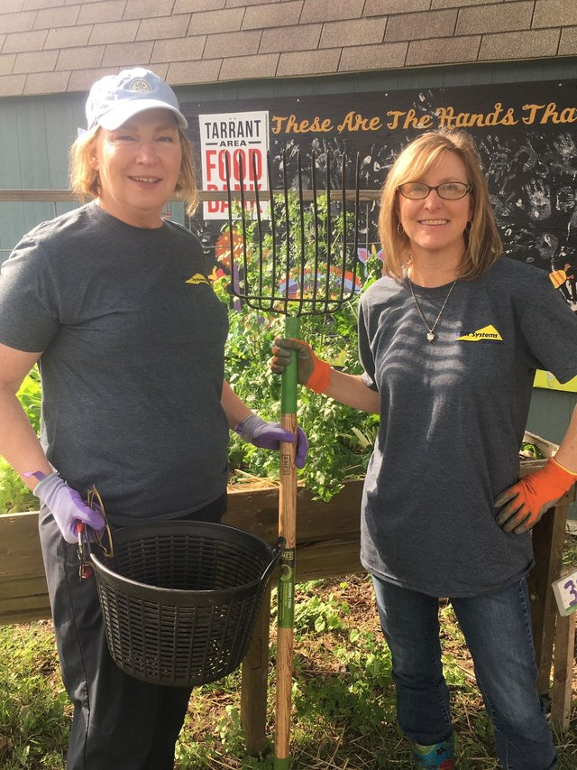 Elbit Systems of America employees Karen Skjolsvik and Zane Smith at Tarrant Area Food Bank Community Garden, 2019